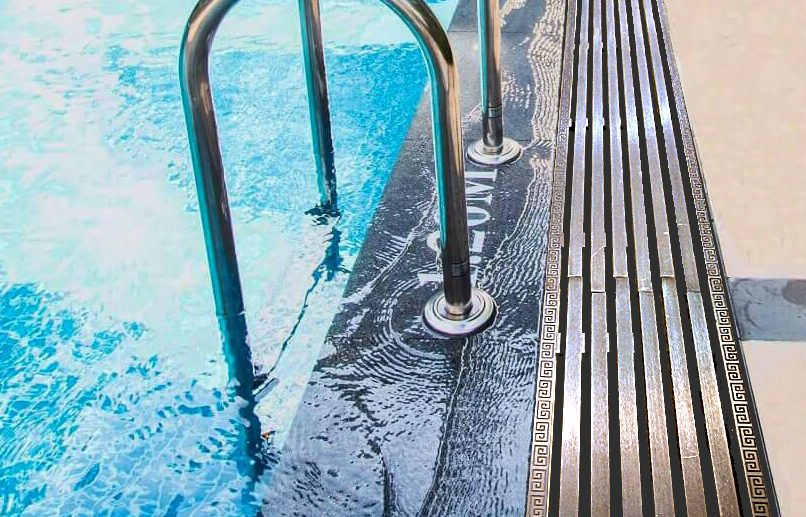 BRASS OVERFLOW GRATING FOR A SWIMMING POOL