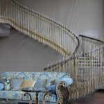 AIRY SPIRAL STAIRCASE WITH BRASS AND GLASS BANISTER
