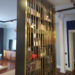 DECORATIVE BRASS PARTITION AND BOOKSHELF