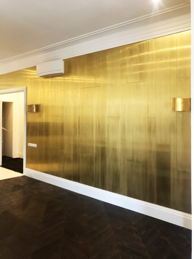 BRASS WALL PANELING IN A LUXURY RESIDENCE AT OSTOZHENKA
